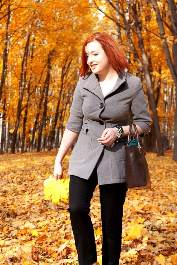 Girl bright colors autumn trees. Autumn landscape.